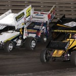 Jarrod Schneiderman (88), Bill Balog (17B), and Mark Dobmeier (13) fight to transfer from the World of Outlaws B Main at Knoxville Raceway on 11 May 2013. - Serena Dalhamer photo