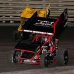 Jamie Ball (5J) and Joe Beaver (53) battle during the Knoxville Raceway 360 sprint feature on 11 May 2013. - Serena Dalhamer photo