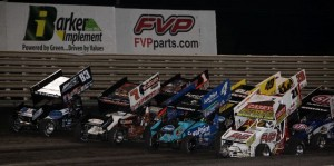 Appropriately, FVP Racing sponsored Brian Brown (21) earns the right to lead the four-abreast salute to the fans prior to the World of Outlaws Sprint feature at Knoxville Raceway on 11 May 2013. - Serena Dalhamer photo