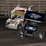 Brian Brown (21) blows by Tim Kaeding (83) at the start of the World of Outlaws Sprint feature at Knoxville Raceway on 11 May 2013. - Serena Dalhamer photo