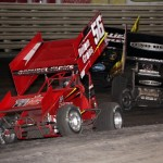 Davey Heskin (56), Steve Kinser (11), and Brad Sweet (49) jockey for position during the World of Outlaws Sprint feature at Knoxville Raceway on 11 May 2013.  - Serena Dalhamer photo