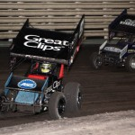 Daryn Pittman (9) and Kyle Larson (1K) battle for 7th during the World of Outlaws Sprint Feature at Knoxville Raceway on 11 May 2013. - Serena Dalhamer photo