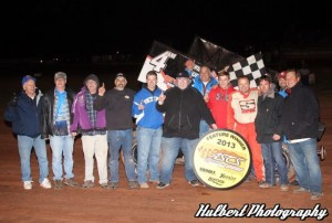 Mike Goodman is joined by friends, family, and crew after winning his first American Bank of Oklahoma Sooner Region event of the 2013 season at the Lawton Speedway on Saturday, May 4. (ASCS / Bryan Hulbert Photo)