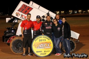 Tony Bruce, Jr. stands with his crew following his victory at the Lawton Speedway with the American Bank of Oklahoma Sooner Region. (ASCS / Thriller Photo).