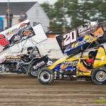 J.R. Stewart (#6) and Butch Schroeder (#20B) during heat race action at Limaland Motorsports Park. - Mike Campbell Photo
