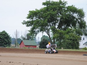 Chad Kemenah passes the pig farm located outside turn three at I-96 Speedway. - T.J. Buffenbarger Photo