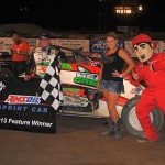 Brady Bacon with the trophy queens and Dusty Dan in victory lane at I-96 Speedway. - T.J. Buffenbarger Photo