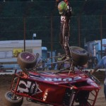 Kyle Larson salutes the crowd after turning his car over doing celebratory doughnuts following his opening night feature win during the 2013 edition of Indiana Midget Week. - Bill Miller Photo