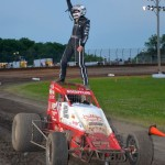 Chad Boespflug salutes the crowd after winning the sprint car feature event at the Gas City I-69 Speedway. - Bill Miller Photo