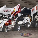 Tanner Edwards (7), Chris Walraven (28), and Cody Ambers (92c) in the 305 feature at Knoxville Raceway on 8 June 2013. (Serena Dalhamer photo)