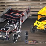 Randy Martin (14) briefly leads Joe Beaver (53) at Knoxville Raceway on 8 June 2013. (Serena Dalhamer photo)