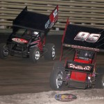 Lynton Jeffrey (12) and Bronson Maeschen (96) battle early for the 410 feature lead at Knoxville Raceway on 8 June 2013. (Serena Dalhamer photo)
