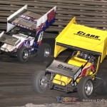 Rager Phillips (10) and Brooke Tatnell (55) swap spots at Knoxville Raceway on 8 June 2013. (Serena Dalhamer photo)