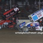 #16 Chris Andrews races side by side for the lead with #09 Craig Mintz during the all star speedweek feature. - Action Photo