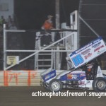 #16 Chris Andrews takes the checkered flag for his first 410 sprint all star speedweek feature win. - Action Photo