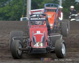 Dave Darland (#41) inside of Robert Ballou (#12) at Gas City I-69 Speedway. - Bill Miller Photo
