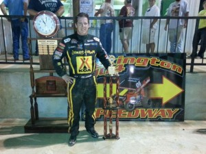 Jason Johnson stands in victory lane at the Lexington 104 Speedway in the Lucas Oil ASCS National Tour's inaugural visit (ASCS / Bryan Hulbert)