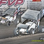Logan Schuchart (#1s) racing with Robby Wolfgang (#1)  Friday at Knoxville Raceway. - Mike Campbell Photo