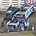 Kyle Larson (#1KL) inside of Cap Henry (#54) for position during Friday night's feature at Knoxville Raceway. - Mike Campbell Photo