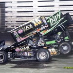 Donny Schatz drives by Kevin Swindell during the feature at Knoxville Raceway. - Mike Campbell Photo