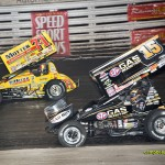 Joey Saldana (#71m) racing with Donny Schatz for second position during the A-Main at Knoxville Raceway. - Mike Campbell / campbellphoto.com