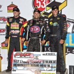 (l to r) Second place Brian Brown, winner Donny Schatz, and third place Justin Henderson after Saturday night's feature at the 53rd Annual FVP Knoxville Natoinals. - Mike Campbell / Campbellphoto.com