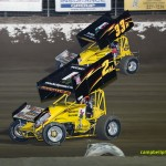 Sheldon Haudenschild (#33M) racing with Dallas Hewitt. (#2M) at Limaland Motorsports Park. - Mike Campbell Photo