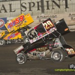 Kerry Madsen (#29) racing with Jac Haudenschild (#59) at Knoxville Raceway. - Mike Campbell Photo