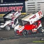 Steve Kinser (#11) racing with R.J. Johnson Thursday at Knoxville Raceway. - Mike Campbell Photo