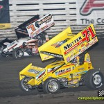 Joey Saldana (#71m) racing with Craig Dollansky (#7) Thursday at Knoxville Raceway. - Mike Campbell Photo