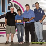 Kendra Jacobs and Steve Post accept their media member of the year awards from the National Sprint Car Hall of Fame and Museum. - Mike Campbell / campbellphoto.com