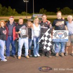 Dave Darland with family and crew in Victory Lane at the Gas City I-69 Speedway. - Bill Miller Photo