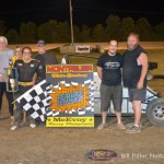 Lynsey Liguori celebrate with family and crew in Victory Lane after winning the midget event at the Montpelier Motor Speedway on Saturday August 17, 2013. - Bill Miller Photo