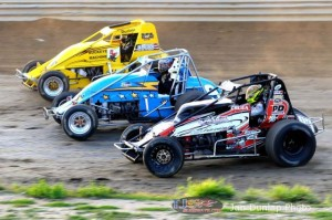 Adam Cruea (#83), Mike Brecht (#9x) and Dallas Hewitt (#2H) race three wide at Waynesfield Raceway Park. - Jan Dunlap Photo