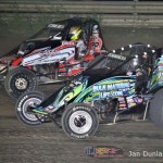 Adam Cruea (#83) and Matt Westfall (#54) racing at Waynesfield Raceway Park. - Jan Dunlap Photo