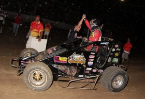Dave Darland recieves a high five in victory lane after winning Friday night's Amsoil USAC National Sprint Car Series feature at 34 Raceway. - Serena Dalhamer Photo