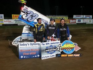 Third place Michael Parent, winner Stuart Friesen, and second place Jason Barney in victory lane at Albany-Saratoga Speedway. - Image courtesy of ESS