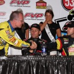 The front row starters for Saturday night's A-Main, Joey Saldana and Brian Brown, shake hands at the post race press conference. - Serena Dalhamer Photo