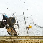 Chad Boespflug upaside down and out of the ball park at Waynesfield Raceway Park. - Mike Campbell Photo