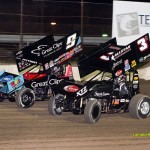 Daryn Pittman (#9) and Shane Stewart (#3g) racing for position at Fremont Speedway. - Mike Campbell Photo