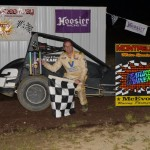 Tate Martz celebrates after winning the midget feature event at the Montpelier Motor Speedway on Saturday September 14, 2013. - Bill Miller Photo