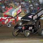 Tony Beaber (#39) racing with Jordan Mackison (#1080)  Saturday night at Fremont Speedway. - Mike Campbell Photo