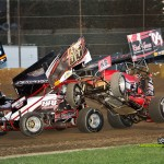 Craig Mintz (#09) climbs over the left rear of Brad Bowman (#55) at Fremont Speedway. - Mike Campbell Photo