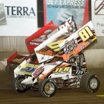 Paige Polyak (#81) inside of Bryan Sebetto (#24) Saturday at Fremont Speedway. - Mike Campbell Photo