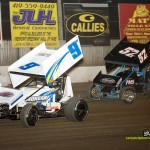 Jac Haudenschild (#9) inside of Andrew Palker (#57x) at Fremont Speedway. - MIke Campbell Photo