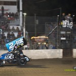 Dale Blaney takes the checkered flag on Saturday night at Fremont Speedway for the Jim Ford Classic. - Mike Campbell Photo