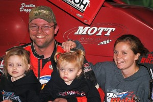 Dustin Daggett with his wife and daughters in victory lane at Berlin Raceway. - T.J. Buffenbarger Photo