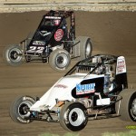 Todd Keen (#18) racing with Scotty Weir (#22s) on Friday at Waynesfield Raceway Park. - Mike Campbell Photo
