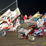 Caleb Griffith (#40) racing with Tim Allison (#11) on Friday at Waynesfield Raceway Park. - Mike Campbell Photo