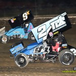 Dale Blaney (#2) racing with Rob Chaney (#9x) during the UNOH All Star Circuit of Champions finale at Eldora Speedway. - Mike Campbell Photo